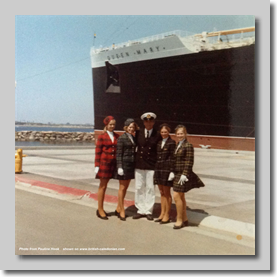 All four of us with the captain of the Queen Mary